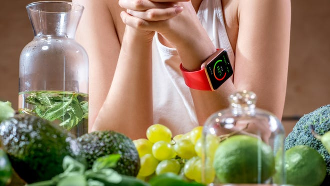 Eating healthy foods and working out are good ways to help with weight loss.