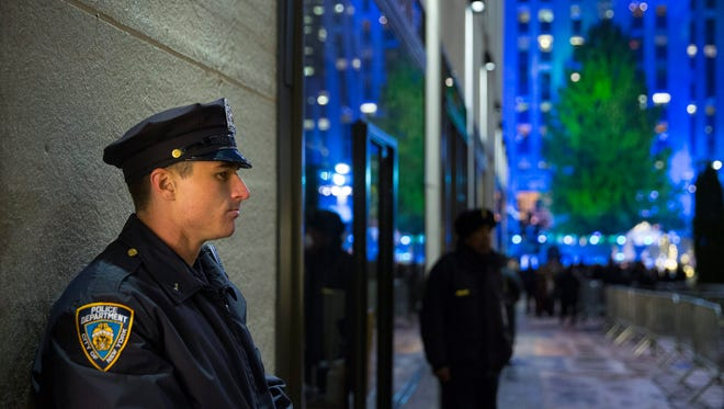 A New York Police Officer stands guard before the 82nd Annual Rockefeller Center Christmas Tree Lighting Ceremony in New York City on Dec. 3.
