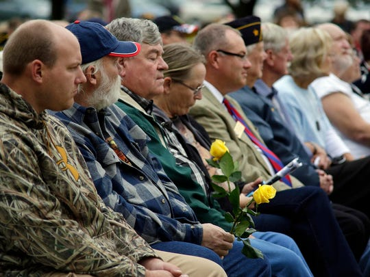 Gold Star family members held gold roses during the