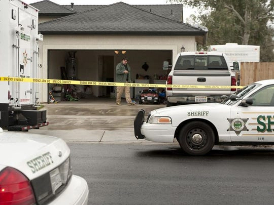 Tulare County Sheriff Department investigates the homicide of Exeter police officer Daniel Green in the 7200 block of West Lickey Court on Saturday, February 7, 2015.