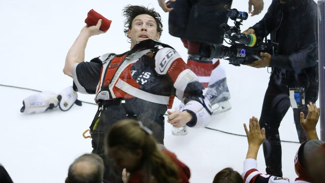 Arizona Coyotes captain Shane Doan (19) throws T-shirts to the crowd following their NHL game Saturday, April 8, 2017 in Glendale, Ariz.
