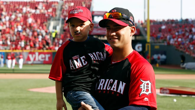 Jul 13, 2015; American League shortstop Jose Iglesias (1) of the Detroit Tigers with his son Jose Iglesias Jr during workout day the day before the 2015 MLB All Star Game at Great American Ballpark.