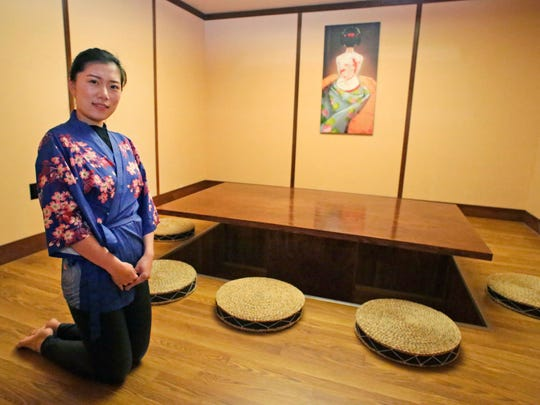 Umi Sushi and Steak House's Cynthia Li, kneels in the Tatami Room, considered a traditional Japanese dining room, Tuesday, February 13, 2018, in Sheboygan, Wis. The firm recently opened at 519 N. 8th Street.