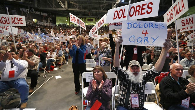 Republican delegates applaud as Rep. Cory Gardner delivers a speech at the state GOP Congress in Boulder, Colo., on April 12, 2014.