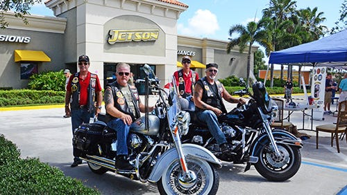 Outside Jetson's Port St. Lucie store, area veterans groups including Rich 'Nitro' Vassar, Jack 'Psych' Eddington, Richard 'Rick' Toft and Tony 'TJ' Pieri of AmVets Post 92 provided information and raised funds for various veterans causes for last year's celebration.  .
