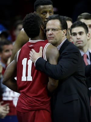 Indiana Hoosiers head coach Tom Crean consoles Indiana Hoosiers guard Yogi Ferrell (11) after the loss to the North Carolina Tar Heels at the Wells Fargo Center on March 25, 2016.