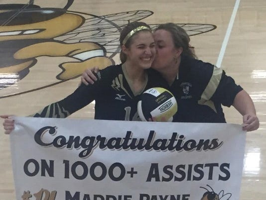 Hayesville junior Maddie Payne, left, is congratulated by coach Tammy Dills after her 1,000th career assist on Monday night.