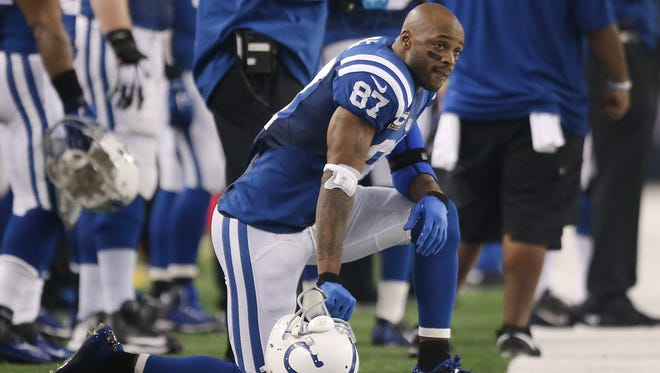Indianapolis Colts wide receiver Reggie Wayne watches the blowout from a knee on the sidelines in the second half. Indianapolis traveled to Dallas for an afternoon game Sunday, December 21, 2014.