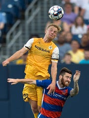 Nashville SC mid-fielder Matt LaGrassa (20) heads the ball against FC Cincinnati's Blake Smith (23) during a game on Saturday, July 7, 2018 at Nissan Stadium in Nashville, Tenn.