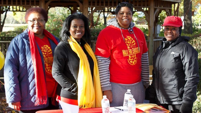 Roslyn Wilson, Latisha King, Patrice Boyd and Deloise Dailey represented the Gamma Psi chapter of Phi Delta Kappa on Saturday morning at Liberty Garden Park.