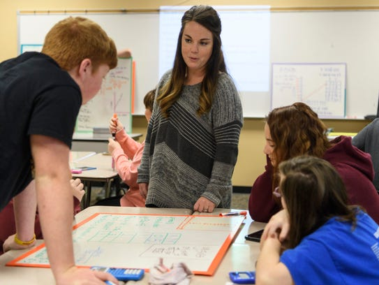 Math teacher Kendra Barrett talks to students as she walks around the room answering questions during a geometry class with junior and senior students at Gibson Southern High.