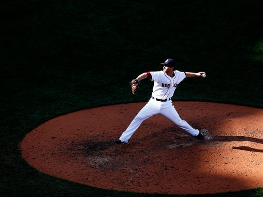 Craig Breslow of the Boston Red Sox pitches against the New York Yankees during the last game of the 2014 season at Fenway Park in Boston.