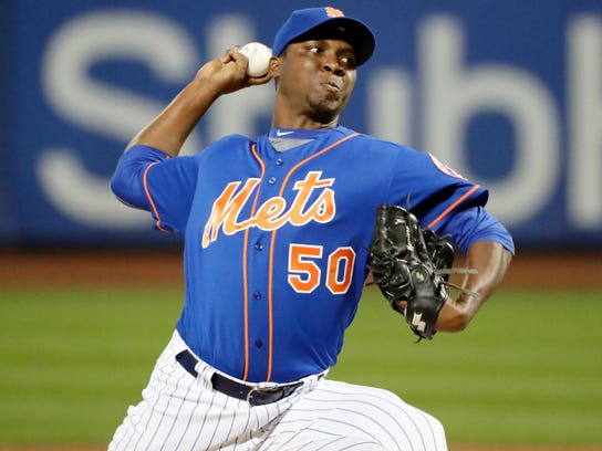 New York Mets' Rafael Montero delivers a pitch during the first inning of a baseball game against the Atlanta Braves on Tuesday, Sept. 26, 2017, in New York. (AP Photo/Frank Franklin II)