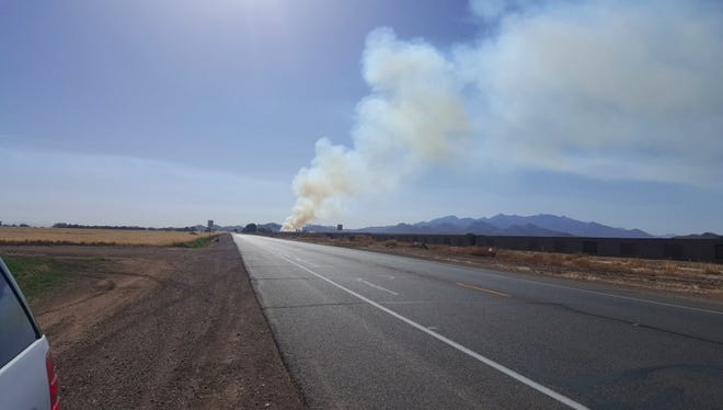 Smoke will emit from the hay fire in Buckeye, which started about 2 a.m. May 20, for several days.