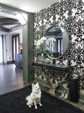 The foyer wallpaper is white, silver and black flocked