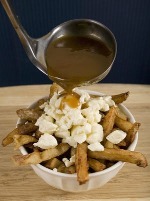 A popular Quebec dish called Poutine consists of french fries, cheese and gravy.