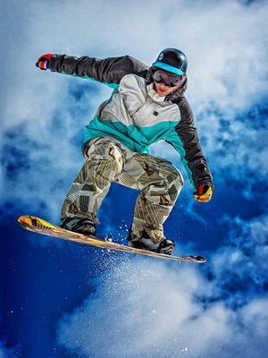 Snow boarders at Treetops Resort near Gaylord this season will be able to practice aerial tricks using a giant air pillow for soft landings.