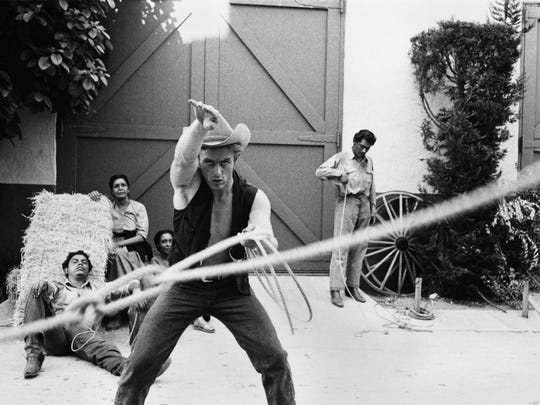 """James Dean performing a rope trick for the camera in """"Giant."""""""
