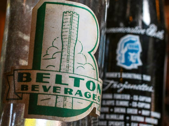 Bottles from Anderson and Belton, including a Belton Beverage Company soda and a commemorative Anderson College Pepsi (1974), are displayed at the Old Depot Antique Mall on Murray Avenue in Anderson.