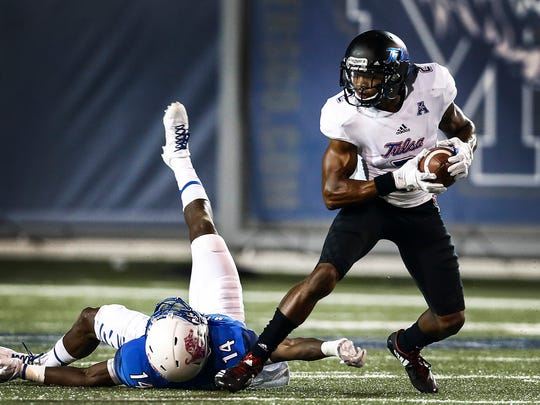 University of Memphis defender Jonathan Cook (left) cannot hang onto University of Tulsa receiver Keevan Lucas (right) during first quarter action at the Liberty Bowl Memorial Stadium.