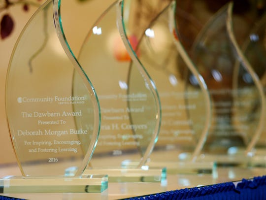 Awards sit on a table waiting to be presented at the