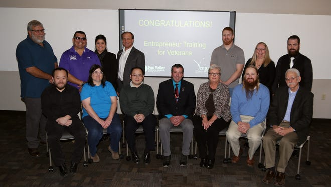 Pictured are veterans who completed the Envoy program and their advisers, first row, from left, Ying Lee; Lisa Enloe; Chue Lee; Bill Trombley, FVTC veterans resource advisor; Ann Schueller; Jonathan Pylypiv; Mark Janness; second row, Roy Landskron; John GonzalezJr.;Amy Pietsch, director of FVTC's Venture Center; Dale Walker, director of Business & Industry Services at FVTC; Matthew Pflughoeft; Patricia Janz; and Galen Sherbon.