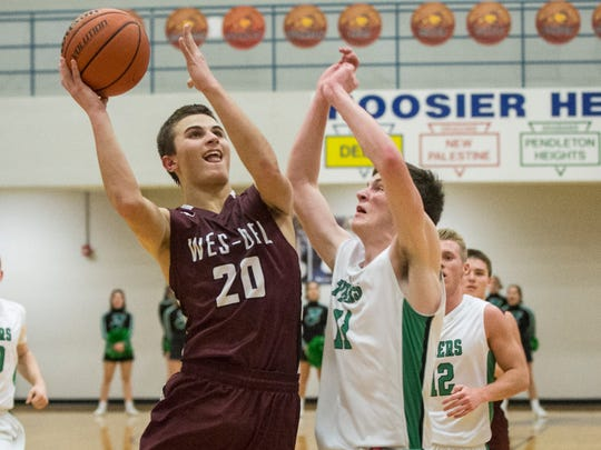 Wes Del's Conner Townsend goes in for the layup during the first round of the Delaware County Boys Basketball Tournament against Yorktown Tuesday night at Delta High School. Wes-Del won the game 53-44.