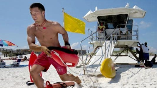 Pensacola Beach lifeguards rescued 500 fewer swimmers in 2014 than they did in 2013 thanks to 126-green-flag surf days.