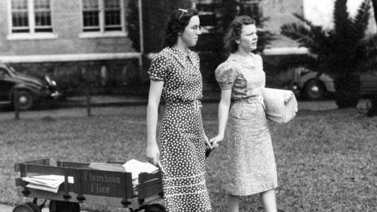 Two members of the Florida Flambeau staff deliver the paper around campus in 1939.