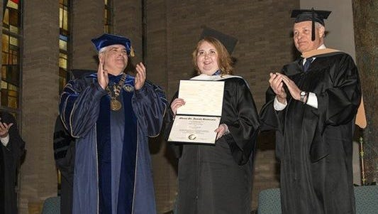 Lauren Hill, an advocate for pediatric brain cancer, was presented with an honorary doctorate from Mount St. Joseph University.