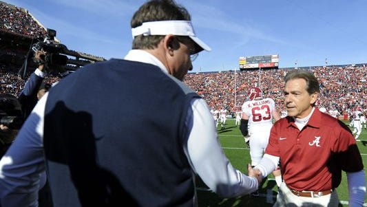 Auburn Coach Gus Malzahn shakes hands with Alabama Coach Nick Saban in this file photo. Both teams are ranked in the top 10 in the coaches poll.