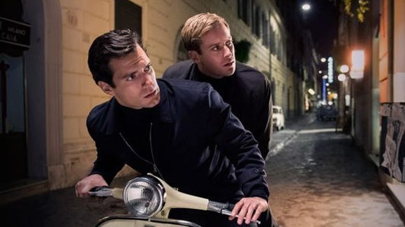 """Henry Cavill, left, and Armie Hammer star as Napoleon Solo and Illya Kuryakin in """"The Man from U.N.C.L.E."""""""