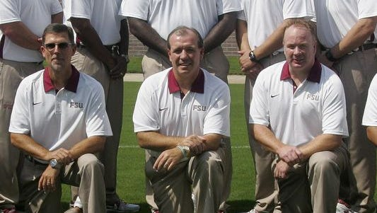 UC offensive coordinator Eddie Gran (Ieft) has taken the same job at Kentucky. Gran worked with UK head coach Mark Stoops (right) under Jimbo Fisher (center) at Florida State from 2010-12.