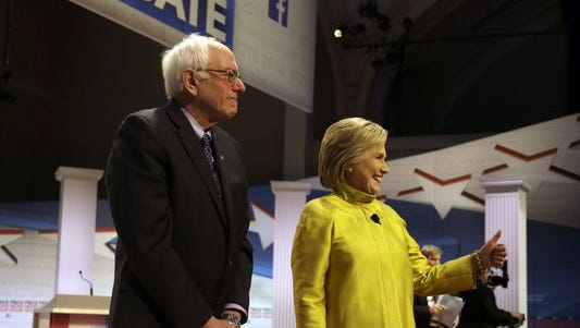 Bernie Sanders and Hillary Clinton take the stage before the Democratic debate at the University of Wisconsin-Milwaukee on Feb. 11, 2016.