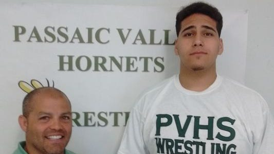 Passaic Valley wrestling coach Joe Benvenuti with senior captain Yousef Karmi.