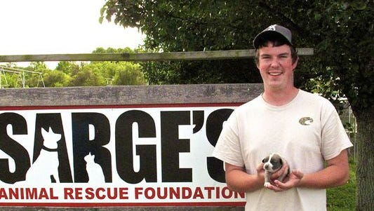 Noah Rogers, of Canton, holds the puppy named in his honor, Noah Blue, at Sarge's animal rescue in Waynesville.