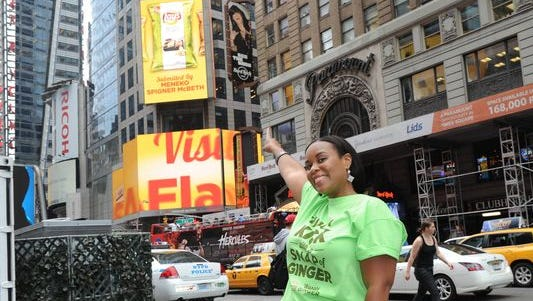 Meneko Spigner McBeth, of Deptford, New Jersey, who submitted Wasabi Ginger, sees her potato chip flavor revealed on a billboard high above Times Square earlier this summer.