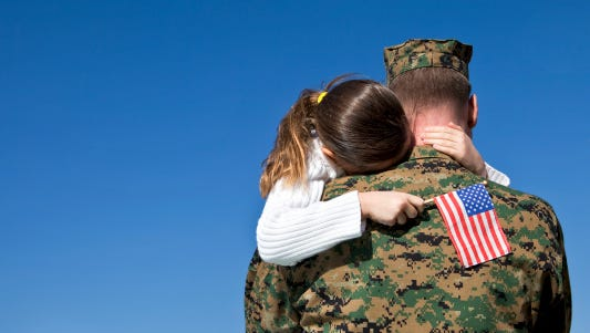FILE -- Marine father and daughter reunited