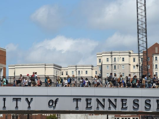 Students filled the pedestrian walkway over Phillip Fulmer Way on the University of Tennessee-Knoxville campus as fall classes began Wednesday, Aug. 17, 2016.