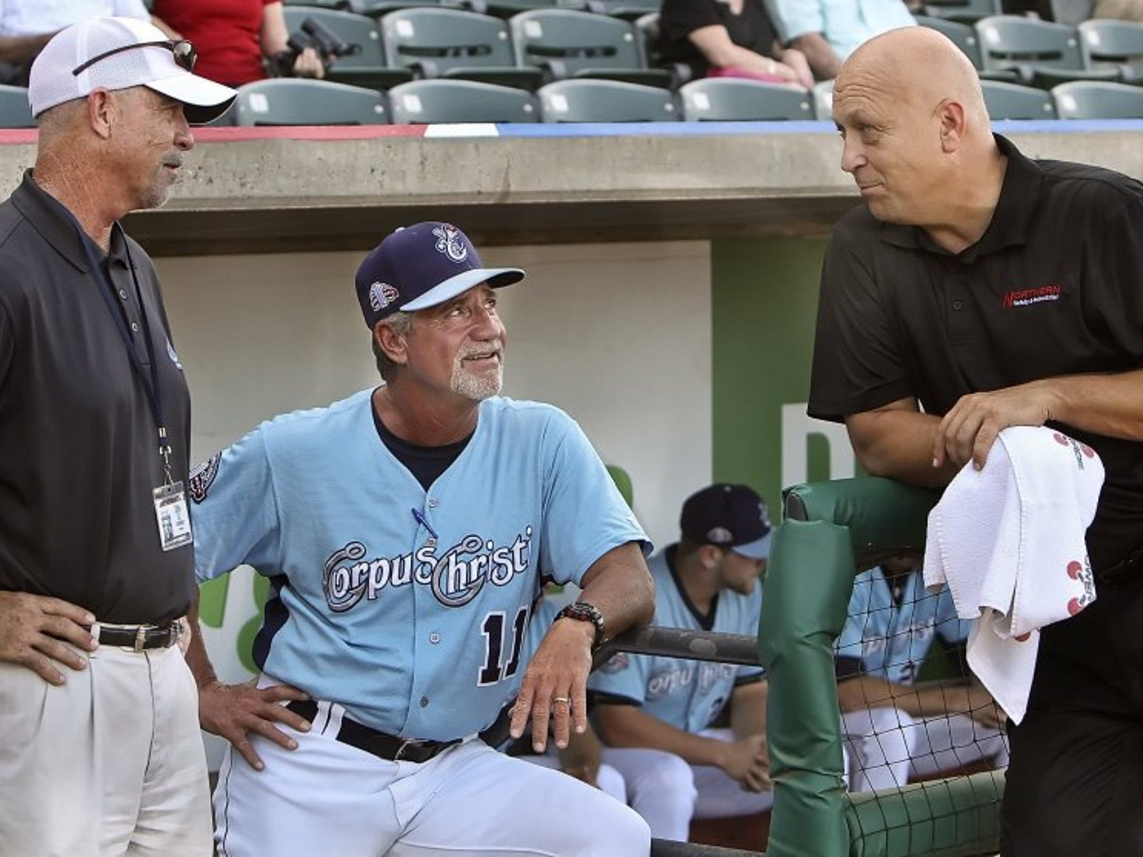 CALLER-TIMES FILE Hooks president Ken Schrom, from left, former Hooks manager Keith Bodie and Cal Ripken Jr. visit prior to a game in 2014 at Whataburger Field. Both Schrom and Bodie will be inducted into the Texas League Hall of Fame.