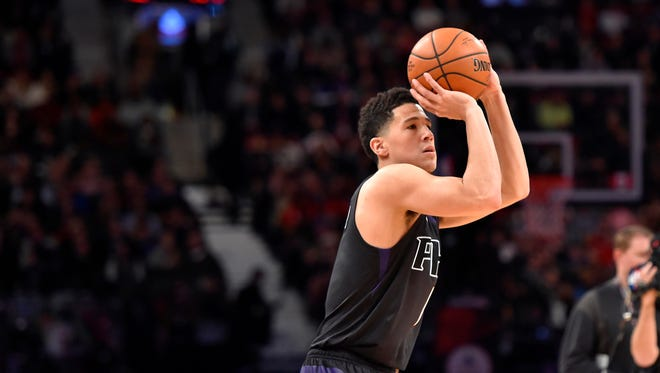 Feb 13, 2016: Phoenix Suns guard Devin Booker competes in the three-point contest during the NBA All Star Saturday Night at Air Canada Centre.