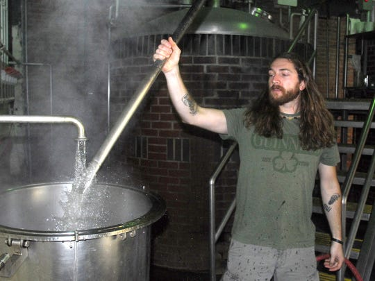Brad Pulver perculates hops at the beginning of the brew process at Arcadia Brewery in this 2010 photo.