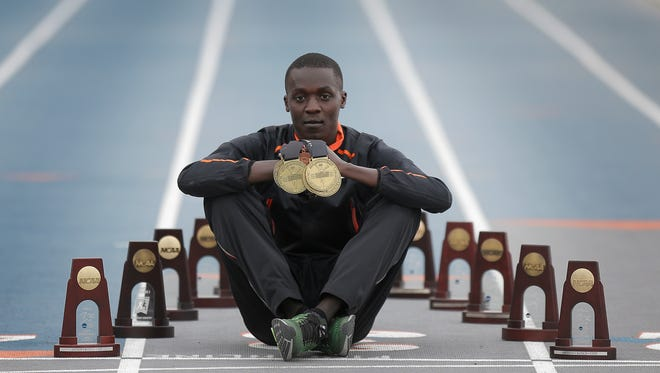 UTEP runner Anthony Rotich, UTEP's most decorated athlete, displays some of the many championship medals and trophies he has won.