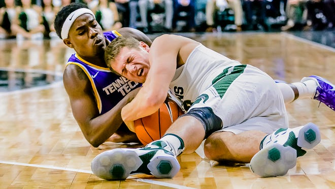 Savonte Frazier ,left, of Tennessee Tech and Matt Van Dyk of MSU fight for the ball after it got away from Van Dyk during their game.