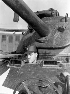 Tanks for the memories: Elvis Presley takes a ride in a tank during his stint in the Army in the late '50s. He was never quite the same after his service days.