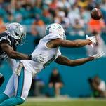 Miami receiver Rishard Matthews dives for a ball during a game against Dallas.