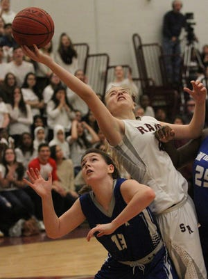 South River's Alyssa Andrejc (4), right, gets a hand on a rebound over Middlesex' Moira Phillips (13) in the Central Jersey Group I final on March 9, 2015. (Photo by Keith A. Muccilli/ Special to NJ Press Media)