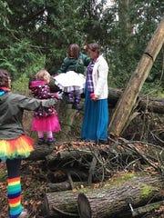 """Girls climb trees during """"Be a Nature Princess"""" at"""