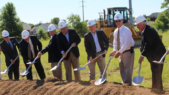 Kentucky Sen. John Schickel, Union Commissioners Ken Heil and Jeremy Ramage, Mayor Larry Solomon, Commissioners Bryan Miller and John Mefford and Kroger Store Manager Jerry Lux at the groundbreaking ceremony for the Union Kroger Marketplace.