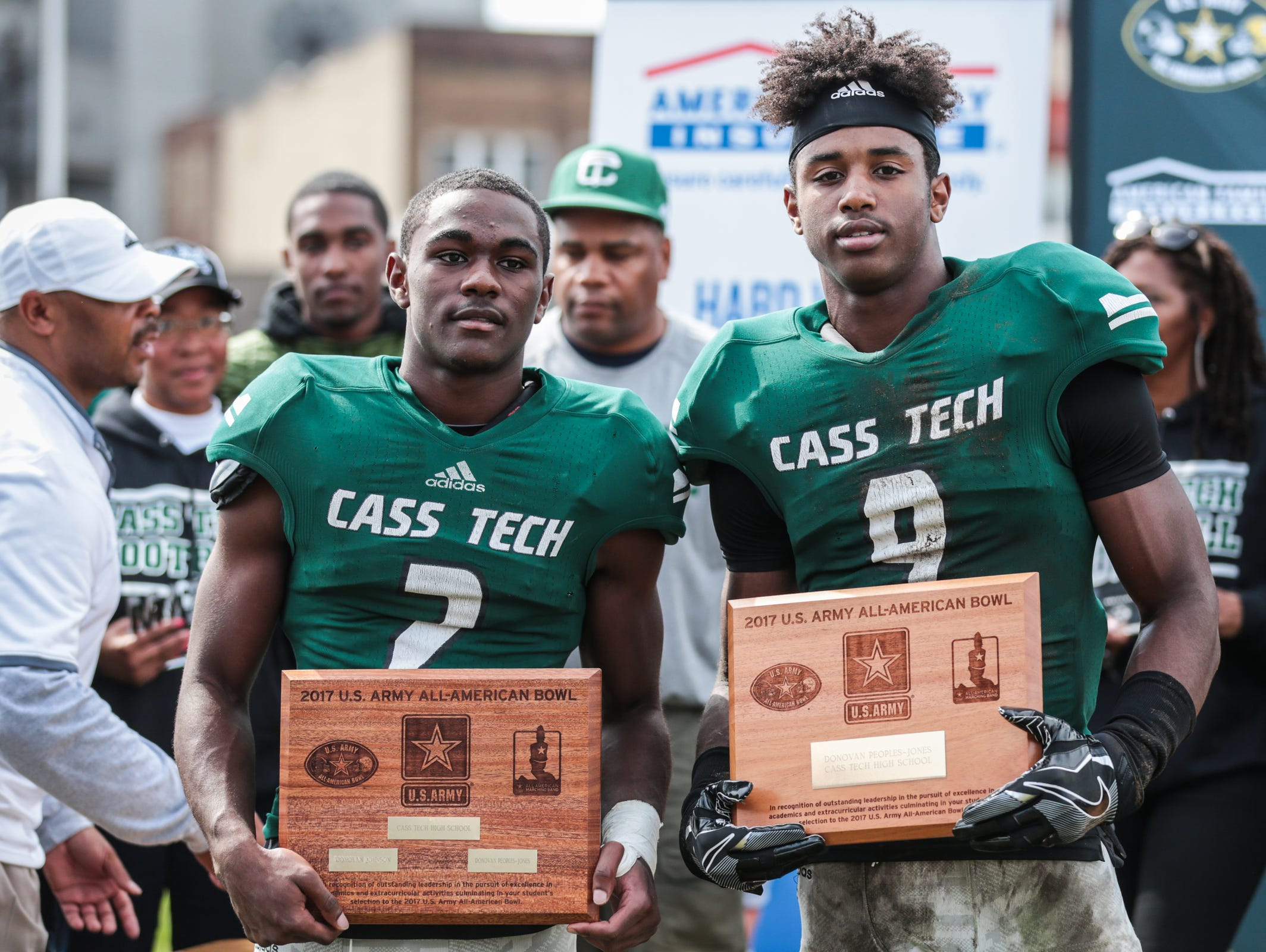 Cass Tech's Donovan Johnson (2) and Donovan Peoples-Jones are honored as 2017 U.S. Army All-Americas during halftime against Detroit King on Oct. 1, 2016, in Detroit.